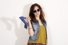 Woman holding a shoe. Women loves shoes concept. Fashion girl and blue high heels shoes. Beautiful young girl in sunglasses royalty free stock photos