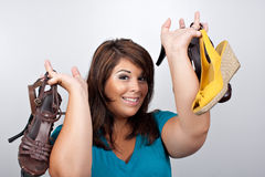 Woman Holding Shoes Stock Photos