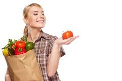 Woman holding a shopping bag Royalty Free Stock Photos