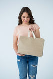 Woman holding shopping bag Royalty Free Stock Images