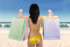 Woman holding shopping bag at beach 1 Stock Image