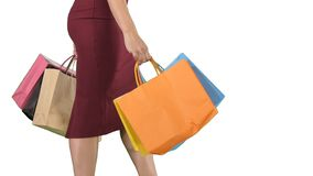 Woman holding shopping bag with colorful walking on white background. royalty free stock photos