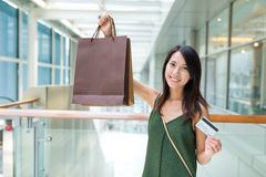 Woman holding shopping bag and credit card Royalty Free Stock Photo