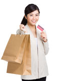 Woman holding shopping bag with credit card Stock Images