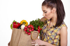 Woman holding a shopping bag full of fresh food Royalty Free Stock Image
