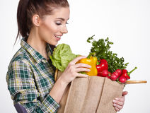 Woman holding a shopping bag full of fresh food Royalty Free Stock Photo
