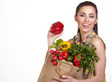 Woman holding a shopping bag full of fresh food Stock Photography
