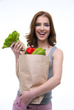 Woman holding a shopping bag full of groceries Royalty Free Stock Photos