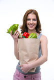 Woman holding a shopping bag full of groceries Royalty Free Stock Images