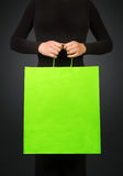 Woman holding shopping bag Stock Images