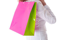 Woman holding a shopping bag on her shoulder Royalty Free Stock Photography