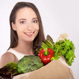Woman holding a shopping bag Royalty Free Stock Photos