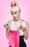Woman holding shopping bag isolated on pink Stock Image