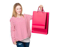 Woman holding with shopping bag Stock Photography