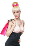 Woman holding shopping bag isolated on white Royalty Free Stock Photography