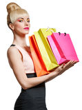 Portrait of beauty woman holding shopping bags, isolated Royalty Free Stock Photos