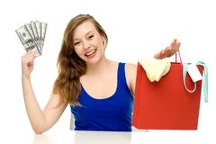 Woman holding shopping bag and money Royalty Free Stock Photography