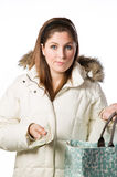 Woman holding shopping bag and passing money Stock Photography