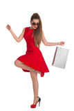 Woman is holding a shopping bag Royalty Free Stock Photo