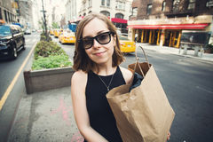 Woman holding shopping bag in Soho, Manhattan, New York. Woman doing shopping on Manhattan, New York City having fun laughing outside in streets of New York in Stock Photos