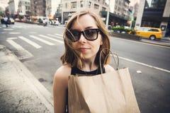 Woman holding shopping bag in Soho, Manhattan, New York Stock Photos