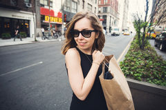 Woman holding shopping bag in Soho, Manhattan, New York Royalty Free Stock Image