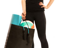 Woman holding shopping bag with sports equipment. Isolated Royalty Free Stock Photo