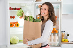 Woman Holding Shopping Bag With Vegetables Stock Photography