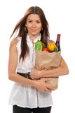 Woman holding shopping bag with vegetarian grocery