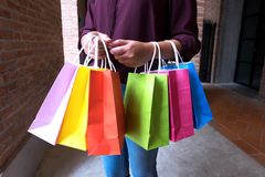 Woman holding shopping bag on vintage street in shopping mall, s royalty free stock images