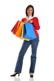 Woman holding shopping bags. Isolated on a white background Royalty Free Stock Photography