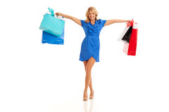 Woman holding shopping bags. To the side Royalty Free Stock Image