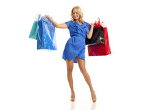 Woman holding shopping bags. Woman in blue dress holding shopping bags Royalty Free Stock Photography