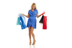 Woman holding shopping bags. Woman in blue dress holding shopping bags Stock Photos