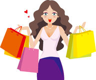Woman holding shopping bags. Are very happy Royalty Free Stock Images
