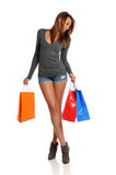Woman holding shopping bags Stock Photos