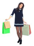 Woman holding shopping bags. Side view of woman holding shopping bags against white background Stock Photos