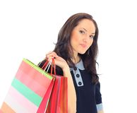 Woman holding shopping bags. Side view of woman holding shopping bags against white background Royalty Free Stock Photos