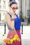 Woman holding shopping bags against Royalty Free Stock Photography