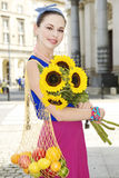 Woman holding shopping bags against Stock Photo