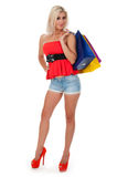 Woman holding shopping bags against Stock Image