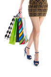 Woman holding shopping bags against white Stock Photo