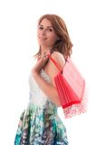 Woman holding shopping bags against a white backgroun Stock Photography