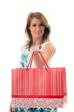 Woman holding shopping bags against a white backgroun Royalty Free Stock Photography