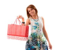 Woman holding shopping bags against a white backgroun Stock Photo