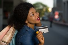 Free Woman Holding Shopping Bags And A Credit Card Royalty Free Stock Photography - 177489747
