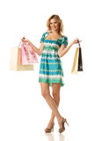 Woman holding shopping bags in both hands Stock Photo