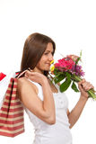 Woman holding shopping bags bouquet  flowers Royalty Free Stock Images
