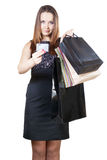 Woman holding shopping bags and a credit card Royalty Free Stock Image