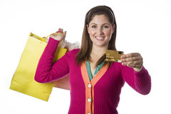 Woman holding shopping bags and credit card Stock Photo
